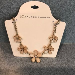 Gold toned floral necklace with iridescent petals